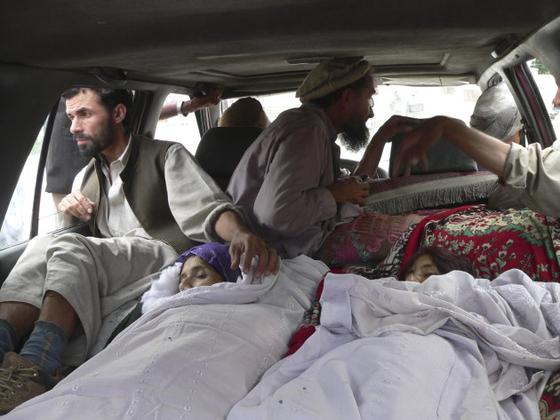 Bodies of Afghan women are brought to a hospital in the Alingar district of Laghman province, east of Kabul, Afghanistan, Sunday, Sept 16, 2012. According to Afghan officials, airstrikes by NATO plane