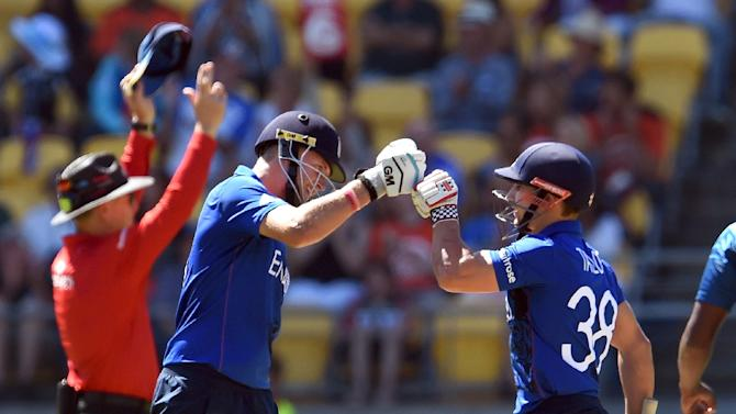 England's batsman Joe Root (L) celebrates another six against Sri Lanka with teammate James Taylor, during their Cricket World Cup Pool A match in Wellington, on March 1, 2015