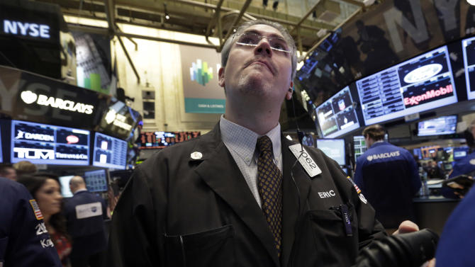 Trader Eric Schumacher works on the floor of the New York Stock Exchange Tuesday, Feb. 5, 2013. Stocks are turning higher in early trading on Wall Street following a spike in home prices and strong earnings reports from Kellogg and other U.S. companies. (AP Photo/Richard Drew)