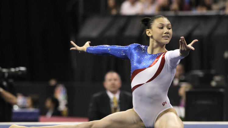 Kyla Ross competes in the floor exercise event during the women's senior division at the U.S. gymnastics championships on Sunday, June 10, 2012, in St. Louis. (AP Photo/Jeff Roberson)