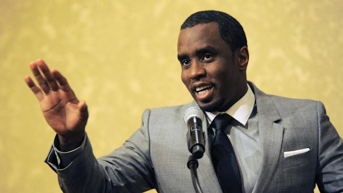 "FILE - In this July 26, 2013 file photo, Sean ""Diddy"" Combs of the new network Revolt TV addresses reporters at the Beverly Hilton Hotel in Beverly Hills, Calif.  The Los Angeles County district attorney's office has declined to file felony charges against Combs for a confrontation in June 2015 at the University of California, Los Angeles, where his son plays football. District attorney spokesman Ricardo Santiago said Thursday, July 2, 2015, his office has decided instead to turn the case over to the Los Angeles city attorney's office.  (Photo by Chris Pizzello/Invision/AP, File)"