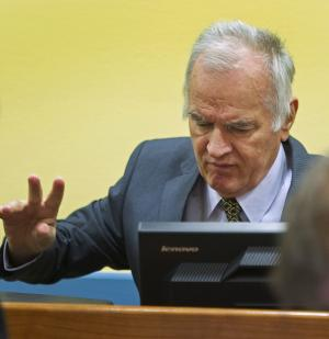 Former Bosnian Serb military commander Gen. Ratko Mladic is seen at the start of his trial at the Yugoslav war crimes tribunal in The Hague, Netherlands, Wednesday May 16, 2012. Twenty years after the opening shots of the Bosnian War, Mladic has gone on trial on charges of genocide, crimes against humanity and war crimes, his appearance at the UN tribunal marks the end of a long wait for justice to survivors of the 1992-95 war that left some 100,000 people dead. (AP Photo/Toussaint Kluiters, Pool)