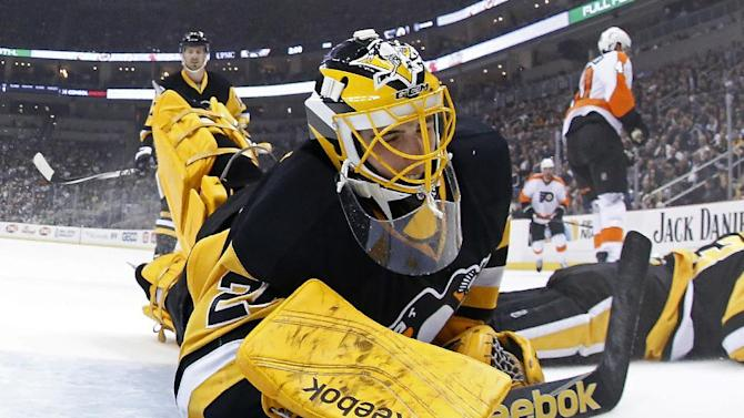 Pittsburgh Penguins goalie Marc-Andre Fleury (29) lies on the ice after allowing a goal to Philadelphia Flyers' Vincent Lecavalier (40) in the first period of an NHL hockey game in Pittsburgh Wednesday, April 1, 2015. The Flyers won 4-1. (AP Photo/Gene J. Puskar)