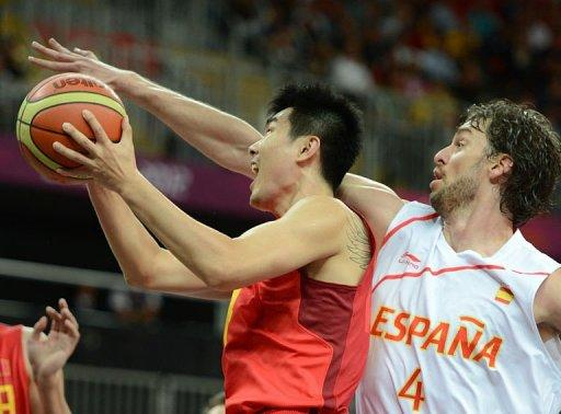 Chinese guard Wang Shipeng (L) is challenged by Spanish forward Pau Gasol