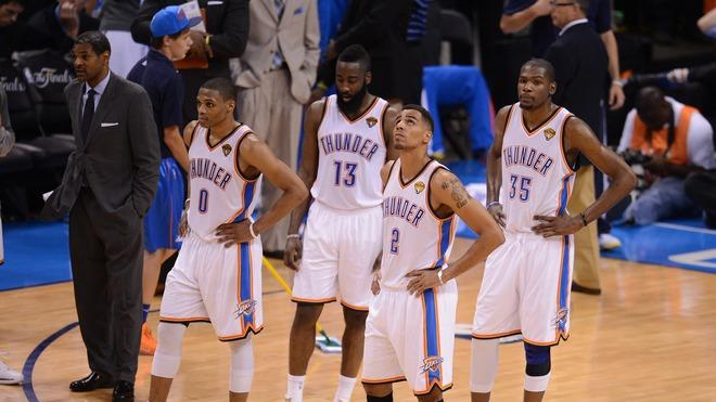 Oklahoma City Thunder's Russell Westbrook (L) James Harden (2L), Thabo Sefolosha (2R) And Kevin Durant (R) Reflect AFP/Getty Images