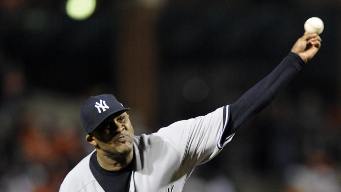 New York Yankees starting pitcher CC Sabathia throws to the Baltimore Orioles in the first inning of Game 1 of the American League division baseball series on Sunday, Oct. 7, 2012, in Baltimore. (AP Photo/Nick Wass)