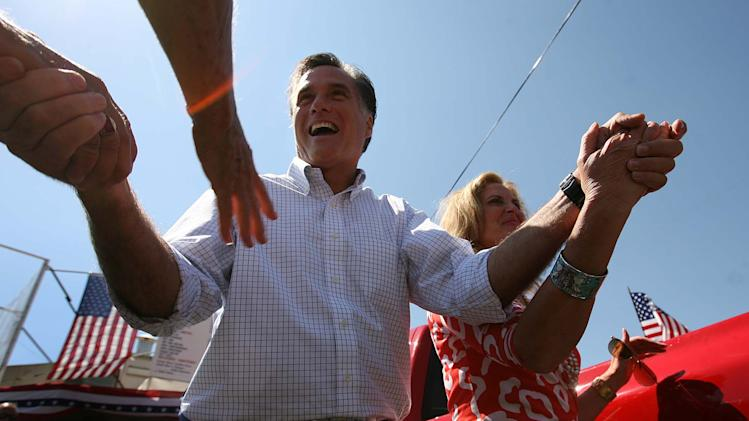 Former Massachusetts Gov. Mitt Romney and his wife Ann make an appearance at the Hires Big H Drive-in near the corner of 400 South and 700 East Friday, June 24, 2011 in Salt Lake City. (AP Photo/The Salt Lake Tribune, Leah Hogsten)  DESERET NEWS OUT; LOCAL TV OUT