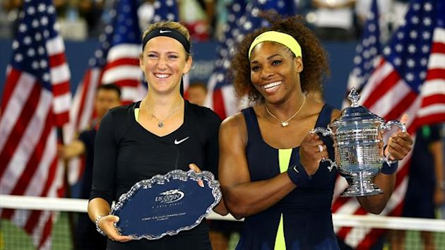 Serena Williams of the United States poses with the US Open trophy next to Victoria Azarenka of Belarus (AFP)
