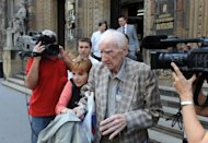Laszlo Csatary leaves the Budapest court building. Hungarian authorities detained, grilled and put under house arrest on Wednesday the 97-year-old who tops the Simon Wiesenthal Center&#39;s dwindling wanted-list of suspected Nazi war criminals