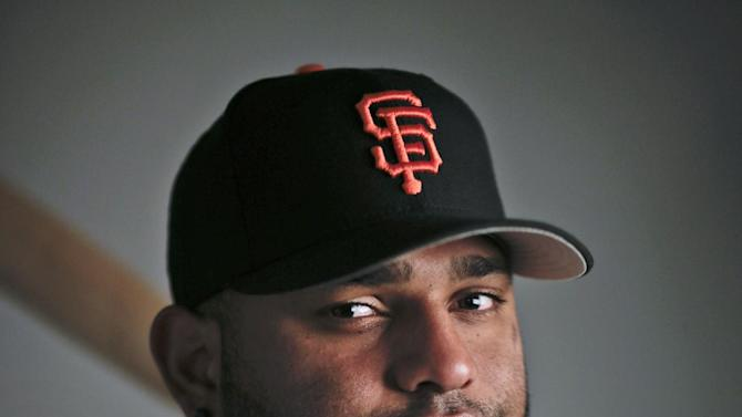 FILE - This 2014, file photo shows San Francisco Giants third baseman Pablo Sandoval. Sandoval and the Boston Red Sox have agreed to a multiyear contract, a person with knowledge of the deal said. The person spoke to The Associated Press on condition of anonymity Monday, Nov. 24, 2014,  because the Red Sox had not announced the agreement. (AP Photo/ Gregory Bull, File)