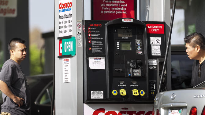 Motorists refuel at the Costco gas station in Burbank, Calif., Friday, Oct. 5, 2012. Californians woke up to a shock Friday as overnight gasoline prices jumped by as much as 20 cents a gallon in some areas, ending a week of soaring costs that saw some stations close and others charge record prices. (AP Photo/Damian Dovarganes)
