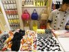 A clerk works at Kate Spade&#39;s new Saturday label store in Tokyo
