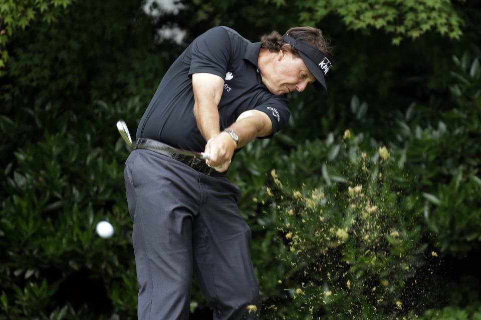 Phil Mickelson tees off on the 11th hole during the first round of the U.S. Open golf tournament at Merion Golf Club, Thursday, June 13, 2013, in Ardmore, Pa. (AP Photo/Morry Gash)