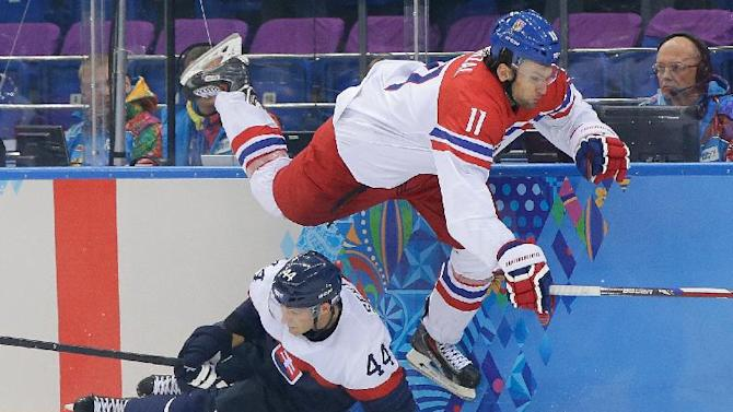 Czech Republic forward Martin Hanzal leaps over Slovakia defenseman Andrej Sekera during the third period of the 2014 Winter Olympics men's ice hockey game at Shayba Arena, Tuesday, Feb. 18, 2014, in Sochi, Russia