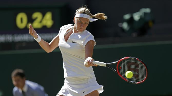 Petra Kvitova of the Czech Republic hits a shot during her match against Jelena Jankovic of Serbia at the Wimbledon Tennis Championships in London