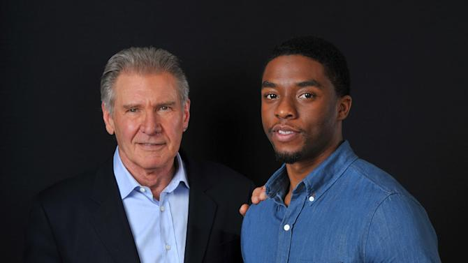 """In this Saturday, March 23, 2013 photo, Harrison Ford. left, and Chadwick Boseman, cast members in the new film """"42,"""" pose together for a portrait, in Los Angeles. Harrison Ford isn't """"yet"""" ready to talk about Disney's planned """"Star Wars"""" sequel, but he will praise its director, J.J. Abrams. The 70-year-old actor -- who came to fame playing Han Solo in the sci-fi trilogy -- is shrugging off questions about that character while promoting his role as Brooklyn Dodgers president Branch Rickey in the Jackie Robinson film """"42."""" (Photo by Chris Pizzello/Invision/AP)"""