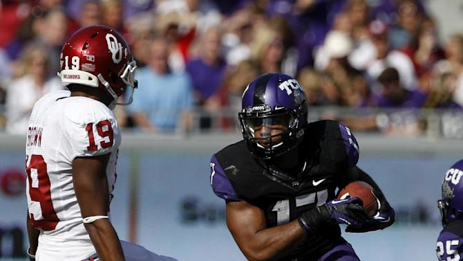 TCU's Sam Carter (17) comes down with an interception on a pass intended for Oklahoma's Justin Brown (19) in the first half of an NCAA college football game Saturday, Dec. 1, 2012, in Fort Worth, Texas. (AP Photo/Tony Gutierrez)