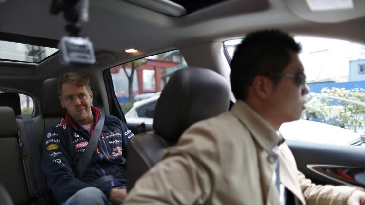 Red Bull Formula One driver Sebastian Vettel of Germany sits in a car during an interview with Reuters ahead of the Chinese F1 Grand Prix in Shanghai