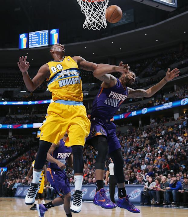 Denver Nuggets forward Darrell Arthur, left, battles for a rebound with Phoenix Suns forward Marcus Morris in the third quarter of the Suns' 103-99 victory in an NBA basketball game in Denver on F