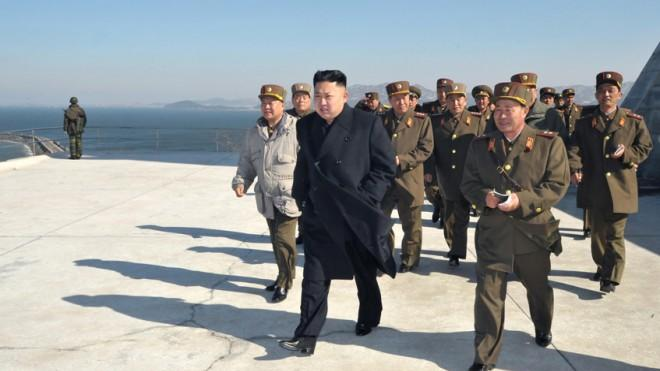 North Korean leader Kim Jong Un inspects a live ammunition firing drill at the Mu Islet Hero Defense Detachment on March 14.