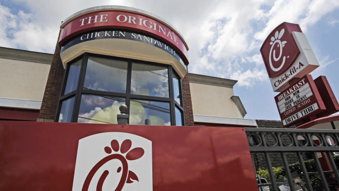 FILE - This Thursday, July 19, 2012 photo shows a Chick-fil-A fast food restaurant in Atlanta. Chick-fil-A, whose founder distinguished the fast-food chain by closing on Sunday out of religious piety, continues to mix theology with business and finds itself on the front lines of the nation's culture wars after its president, Dan Cathy, confirmed his opposition to gay marriage in June 2012. (AP Photo/Mike Stewart)