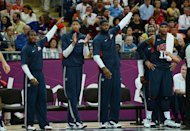 US players react during the men&#39;s basketball preliminary round match Argentina vs USA as part of the London 2012 Olympic Games at the Basketball Arena in London. Kevin Durant scored 28 points and the US NBA Dream Team defeated Argentina 126-97 on Monday to remain undefeated and book an Olympic quarter-final date Wednesday against Australia