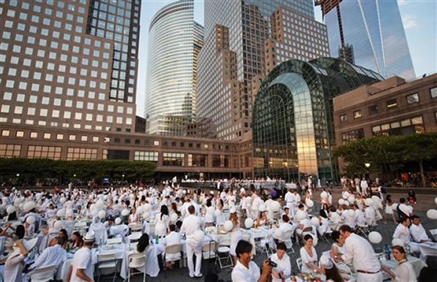As part of the Diner en Blanc flash-mob dinner on Aug. 20, 2012, 3,000 people all dressed in white, descended on the Lincoln Center for the Performing Arts. (AP photo)
