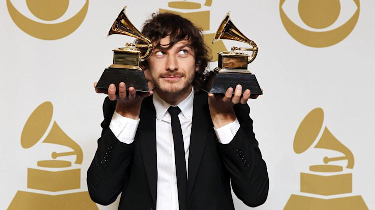 "Gotye poses backstage with the awards for best pop duo/group performance for ""Somebody That I Used to Know"" and best alternative music album for ""Making Mirrors"" at the 55th annual Grammy Awards on Sunday, Feb. 10, 2013, in Los Angeles. (Photo by Matt Sayles/Invision/AP)"