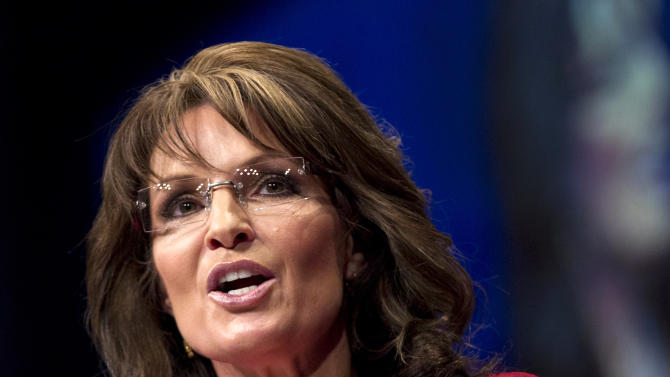 FILE - In this Feb. 11, 2012 file photo, Sarah Palin, the GOP candidate for vice-president in 2008, and former Alaska governor speaks in Washington. Sarah Palin and George W. Bush won't be in Tampa. Hillary Rodham Clinton and Al Gore aren't making the trip to Charlotte. And scores of other Republican and Democratic stars are taking a pass as their parties gather at every-four-years national conventions. The reasons are varied _ and political.    (AP Photo/J. Scott Applewhite)