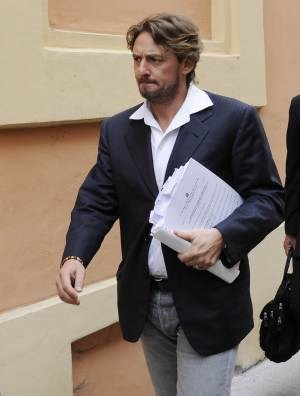 """Giuseppe Signori arrives at the Cremona court, Italy, Wednesday, June 8, 2011. Former Lazio captain Giuseppe Signori was among 16 people arrested last week for alleged involvement in a match-fixing and betting ring throughout Italy. The prosecutor leading the latest inquiry into match-fixing in Italy believes there are """"big problems"""" for Serie A. Cremona prosecutor Roberto Di Martino has been coordinating questioning for several of the 16 people arrested across Italy last week. Di Martino said last week that the inquiry is focused on 18 matches mostly in Serie B and C, but key suspects in the case have reportedly divulged information about top division games that were fixed. (AP Photo/Antonio Calanni)"""