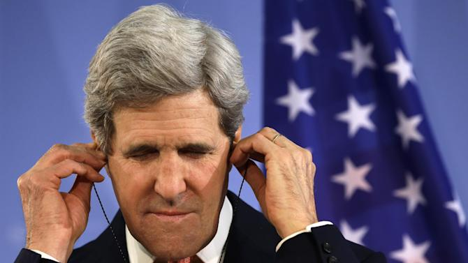 U.S. Secretary of State John Kerry adjusts his translation earphones while listening to German Foreign Minister Guido Westerwelle, not pictured, at a news conference at the Foreign Ministry in Berlin on Tuesday, Feb. 26, 2013. Berlin is the second stop in Kerry's first trip overseas as secretary. (AP Photo/Jacquelyn Martin, Pool)