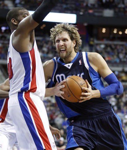 Mavericks blow lead but beat Pistons 102-99