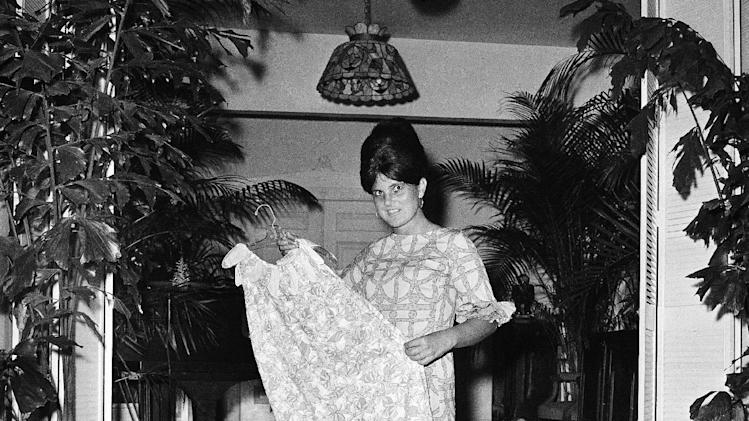 FILE - In this March 16, 1965 file photo, Palm Beach the fashion designer Lilly Pulitzer, wears her own design and creation of the Lilly shift, in Palm Beach, Fla. Pulitzer, known for her tropical print dresses, dies in Florida at 81. (AP Photo/Robert H. Houston, File)