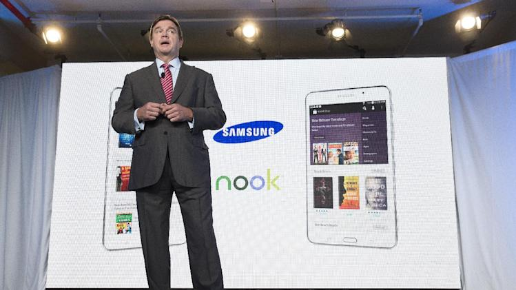 Mike Huseby, CEO of Barnes & Noble, speaks during the unveiling of the Samsung Galaxy Tab 4 Nook, a tablet that will replace B&N's Nook, Wednesday, Aug. 20, 2014, in New York. The 7-inch tablet will sell for $179 after a $20 instant rebate, the same entry price of the non-branded Samsung Galaxy Tab 4. (AP Photo/John Minchillo)