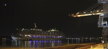 The Carnival Triumph cruise ship is towed towards the port of Mobile