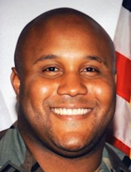 <p>Fired Los Angeles Police Department (LAPD) officer Christopher Dorner seen in an undated photo wearing a military uniform. More than 100 officers have been searching in the mountains since Thursday for Dorner, 33.</p>