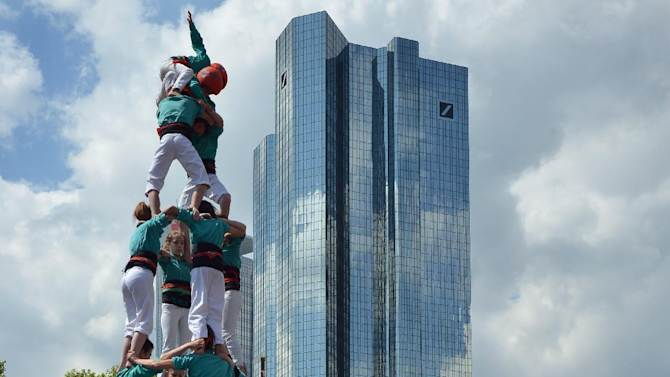 """IMAGE DISTRIBUTED FOR HIT RADIO FFH -  Members of the 'Castellers de Villafranca' Human Tower Team form a 'castell' by Deutsche Bank Tower in Frankfurt, Germany, on Saturday, May 25, 2013.  The """"Frankfurt Skyscraper-Festival 2013"""" organised by """"HIT RADIO FFH"""", one of Germany's most listened to radio stations, opens up 18 of Frankfurt's skyscrapers free of charge to 80,000 visitors over the weekend of May 25/26, 2013. In addition to the high rise access to these buildings a number of fringe events run in conjunction with the festival including base jumping which brings hundreds of thousands of visitors into the city centre.  Frankfurt has more skyscrapers than any other European city situated close together in the downtown area of the financial capital of Germany. (Kai-Uwe Waerner/Radio FFH via AP Images)"""
