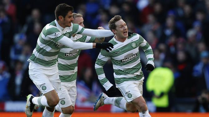 Celtic's Commons celebrates with teammates after scoring against Rangers during their Scottish League Cup semi-final soccer match at Hampden Park stadium in Glasgow