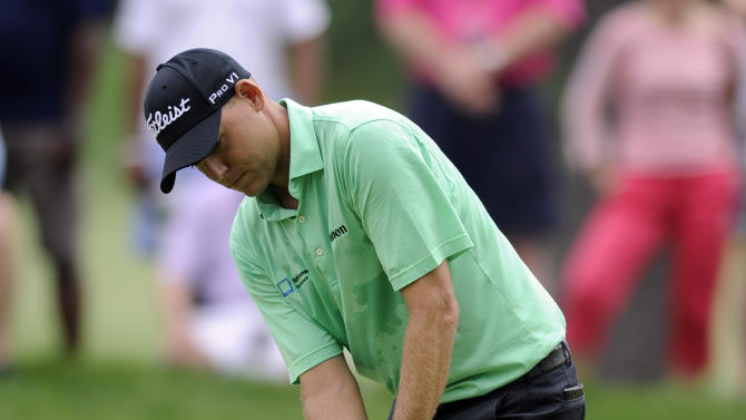 Bill Haas putts on the third green during the final round of the AT&T National golf tournament at Congressional Country Club, Sunday, June 30, 2013, in Bethesda, Md. (AP Photo/Nick Wass)