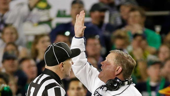 Notre Dame head coach Brian Kelly argues a call during the first half of the BCS National Championship college football game against Alabama Monday, Jan. 7, 2013, in Miami. (AP Photo/David J. Phillip)