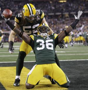 FILE - This Feb. 6, 2011, file photo shows Green Bay Packers' Nick Collins (36) celebrating with teammate Clay Matthews (52) after returning an interception for a touchdown during the first quarter of the NFL football Super Bowl XLV game against the Pittsburgh Steelers, in Arlington, Texas. NFL owners and players agreed early Monday, July 25, 2011 to the terms of a deal to end the lockout, and players were expected to begin the voting process later in the day, two people familiar with the negotiations told The Associated Press. The people spoke on condition of anonymity because the process was supposed to remain secret and no formal announcement had been made. (AP Photo/Paul Sancya, File)
