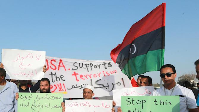 Demonstrators carry signs bearing messages against talks headed by U.N. Special Envoy Bernardino Leon during a demonstration in Benghazi