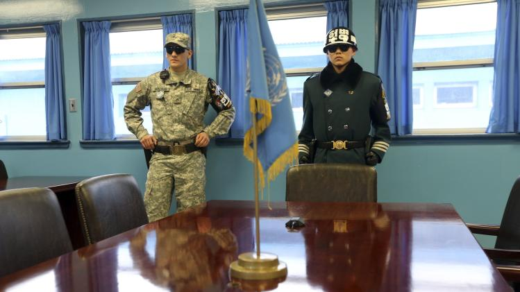 Soldiers of South Korea and U.S. stand guard in U.N. Command Military Armistice Commission Conference Building at truce village of Panmunjom in demilitarised zone dividing two Koreas, in Paju