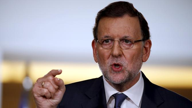 Spain's PM Rajoy gestures during his news conference after weekly cabinet meeting at the Moncloa Palace in Madrid
