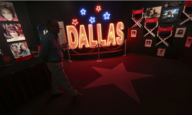 In this photo made Tuesday, Nov. 13, 2012, a tourist looks at the Dallas TV show museum at Southfork Ranch in Parker, Texas. Tourists have been flocking to Southfork Ranch since the early years of the