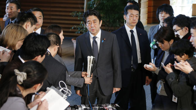 """Japanese Prime Minister Shinzo Abe speaks to the reporters after meeting with Finance Minister Taro Aso, Economics Minister Akira Amari and Bank of Japan Gov. Masaaki Shirakawa, at the prime minister's official residence in Tokyo, Tuesday, Jan. 22, 2013. Japan's Prime Minister Shinzo Abe declared a """"monetary regime change"""" Tuesday as the central bank bowed to government pressure, setting a 2 percent inflation target aimed at helping the country emerge from its prolonged bout of deflation. (AP Photo/Koji Sasahara)"""