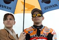 Australian rider Casey Stoner and his wife Adriana Tuchyna waits on the grid ahead of the MotoGP race at the British Grand Prix at Silverstone racetrack near Northampton. Lorenzo cruised to a comfortable win over Stoner in the British MotoGP, with Spaniards also clinching the Moto2 and Moto3 categories