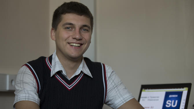 Sergei Ovcharenko, the director for .su domain development at Moscow's Foundation for Internet Development smiles as he speaks to The Associated Press photographer in his office in Moscow, Russia, on Thursday, May 30, 2013. The Foundation for Internet Development is responsible for managing the Soviet Union's old .su domain, which security experts say has become a magnet for hackers. Ovcharenko acknowledges that criminal sites hosted in Soviet cyberspace can stay online for extremely long periods of time, something he blames on weak Russian legislation and outdated terms of service. He promises that stricter rules are on their way. (AP Photo/Alexander Zemlianichenko)