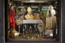 A Pope John Paul II statue is displayed in a tailor shop window in Rome