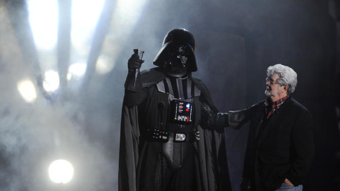 """""""Darth Vader"""" accepts the Ultimate Villain award from """"Star Wars"""" creator George Lucas during the 2011 Scream Awards, Saturday, Oct. 15, 2011, in Los Angeles. The award show is dedicated to the horror, science fiction and fantasy genres of feature films, television and comic books. (AP Photo/Chris Pizzello)"""